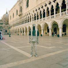 Liu Bolin poses on Piazza San Marco in Venice