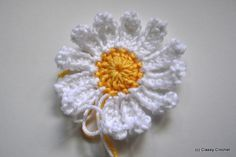 Crochet Daisy Tutorial | Classy Crochet. Thinking this would make a pretty dishcloth with a scrubby in the middle.