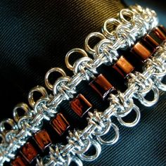 Here is a handmade, original design chain maille bracelet made by yours truly. The chain maille is crafted of shiny, anodized jeweler-grade aluminum (nickel free, tarnish free) & the beads are fire-polished glass. The beads are not strung together, instead they are each individually woven into the actual chain maille. Each bracelet is handmade to order.  Bracelet is 7.5 inches in length.