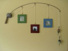 Fishing pole made of metal wire. Fishing line is cotton cord coated and sealed. The reels, bobbers and pole handles are made from wood. Picture frames made of wood with glass insert. Dimensions of frames are 5 in x 5 in. Entire frame is sprayed with a clear seal coat.