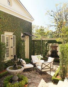 side yard courtyard, gravel, awning over door, ivy on brick, etc.
