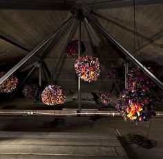 """Phyllida Barlow, """"RIG: untitled; pompoms,"""" 2011. Fabric, paper. 15 large fabric balls. Overall installed dimensions: 109 × 341 × 316 7/8"""". Work in situ. Dimensions variable. Installation view. Hauser & Wirth. London, Piccadilly, 2011. © Phyllida Barlow. Courtesy the artist and Hauser & Wirth. Photo: Peter Mallet."""
