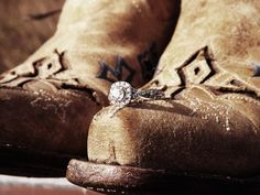 Messing around with the camera today. This shot is a cute engagement ring and boot pic. #rustic