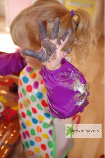 How-to pumpkin painting with toddlers featuring Sleevie Savers. Gift for Grandma!  Pumpkin painting, fall art project, fall craft project. Sleeve covers, sleeve protectors for children.