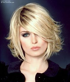 Short hairstyle with back that flips up.  Straight and smooth sides surround the face, while the back flips up in various angles. Use gel, smoothing lotion and gloss.