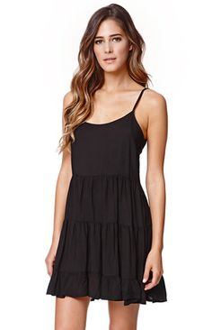 """A PacSun.com Online Exclusive!The Tiered Babydoll Dress by LA Hearts for PacSun.com features a ruffle tiered style and open back detail. The dress is unlined and has thin, adjustable straps.   27"""" length excluding length of straps Measured from a size small Model is wearing a small Her Measurements: Height: 5'9"""" Bust: 34"""" Waist: 24"""" Hips: 34"""" Machine washable 100% polyester Made in USA"""