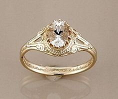 Wouldn't necessarily choose this for myself, but I am open to unique rings that no one else has! I love the gold! love the oval cut! And love the antique feel!