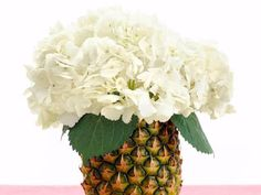 A pineapple vase?! See how to turn fruit into baby shower decorations on HGTVs Design Happens Blog. (http://blog.hgtv.com/design/2013/04/22/fruit-baby-shower-decorations/?soc=pinterest)
