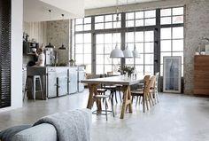 Open airy loft kitchen + dining. Windows.