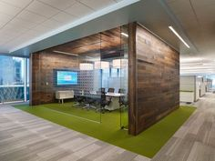 Meeting room idea - wooden walls with glass walls (provides partial privacy and partial transparency)