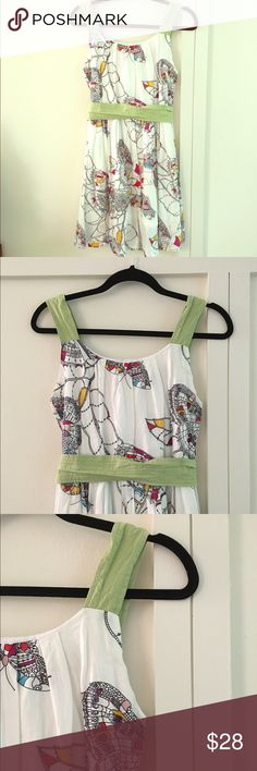 UNIQUE COTTON SUNDRESS Unique cotton sundress with butterfly pattern. Green belt is removable. Fitted top with full skirt. White cotton lining. Small rip in lining at waist but not visible. 100% cotton. Back zipper. Bust is 33 inches. Waist is 31 inches. Total length is 34 inches. Luv2Luv Dresses