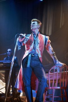 David Bowie performs in Roseland in 1996, wearing a Union Jack coat designer by Alexander McQueen.
