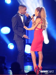 Big Sean and Ariana Grande perform at A Very GRAMMY Christmas at The Shrine Auditorium on November 18, 2014 in Los Angeles, California. (Photo by Jason LaVeris/FilmMagic)