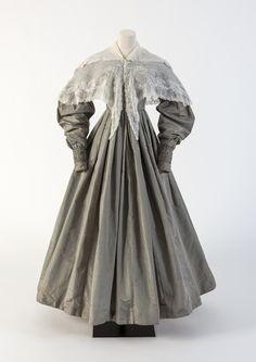 OBJECT 35 - Grey silk taffeta day dress worn with a Whitework embroidered collar, 1830s. Fashion Museum Bath.