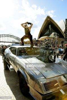 Sebastian Dickins, playing a Warboy, with Max's car at the Sydney Opera House during a special promotion ahead of the premiere of the film 'Mad Max: Fury Road' on May 13, 2015 in Sydney, Australia.