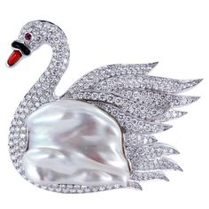 Charming Diamond Swan Pin Unknown Contemporary Platinum swan pin consisting of one Baroque pearl and 5.60 carats total weight of pave set full cut diamonds.