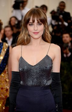 Dakota Johnson Dazzles in Shades of Blue: Dakota Johnson made a splash at the 2014 Met Gala in the Metropolitan Museum of Art's Anna Wintour Costume Center on Monday night, walking her first red carpet at the annual event.