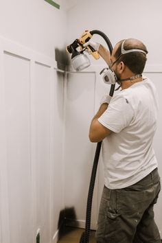 Everything you need to know for how to use a paint sprayer on walls! You can also use it on furniture, cabinets, and more! Do furniture makeovers, paint your exterior, or redecorated and paint a whole room! The Wagner Flexio 5000 is so easy to use with paint, stain or paint and primer! Find out how to prep and clean out your sprayer too. Video tutorial included! #painting #interiorwalls #paintsprayer #renovations #review Home Paint Colour, Paint Color Palettes, Wagner Paint Sprayer, Using A Paint Sprayer, Gallon Of Paint, Blogger Home, Buying A New Home, Board And Batten, Beautiful Interior Design