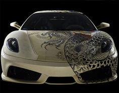 French are making a great mix of cars and tattoos. Here a Ferrari covered in tattooed leather by contemporary artist Philippe Pasqua.