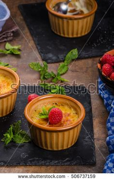 Delicious creme brulee with rapsberries, crusted caramel on top