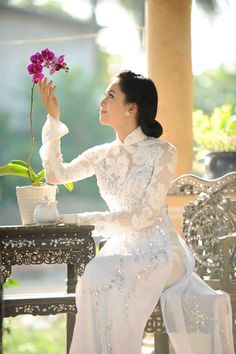 Vietnamese lace ao dai.        ///////.     Vietnamese/English wedding invitation @ www.ThiepCuoiCali.com.        ///////////.