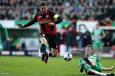 Niklas Moisander (R) of Bremen and Mike Frantz (L) of Freiburg compete for the ball during the Bundesliga match between Werder Bremen and SC Freiburg at Weserstadion on October 29, 2016 in Bremen, Germany.