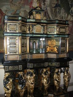 The Pierre Golle cabinet. It has twenty-four various-sized drawers (both visible and secret drawers!) which surround a central cupboard enclosing a mirror-lined and stepped interior. The cabinet is panelled with light brown marble imitating buildings in landscapes, the borders inlaid with brass and pewter scrolling foliage and plaques and painted to imitate marble. It is sat on giltwood paw feet. The cabinet dates from 1670-1700.  -Nostell Priory & Parkland- European Furniture, French Furniture, Antique Furniture, Louis Xiv, Louis Quatorze, Parquetry Floor, Dutch Republic, Art Cabinet, Federal