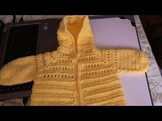 This is part 1 of the video to crochet this beautiful hoodie sweater.  This sweater is sized to fit 6 - 12 month old babies.  The sweater is worked with a DC crochet stitch and an open weave stitch pattern on the yoke.  The sweater features a hoodie to keep baby warm.  This step by step tutorial will allow you to be able to create this sweater f...