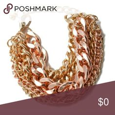 A Must See Rose and Gold Chunky Bracelet Mixed 7 strand rose gold with gold chain bracelet ( 3 rose gold 4 yellow gold ) makes this piece chunky and very stunning. One Size fits all with adjustable lobster clasp and chain extender. Great statement piece for any outfit.  Material Content: 18k Plated Base metals Nickel and Lead free One Size Adjustable / Lobster Clasp  -Offers Considered with Bundles  -Price Firm unless Bundled -No Trades No Holds  -Item new with tags or in original…