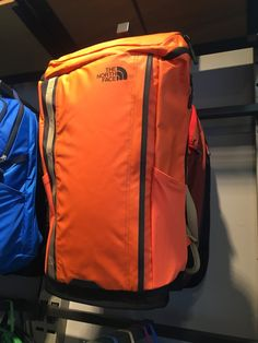Northface backpack with a water-repellant exterior and opens up through the top with a zipper. Also opens to the main compartment from a side zipper.