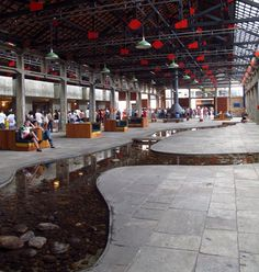 We love the #indoor river separating spaces in this social center #recycled from an old #factory. #design