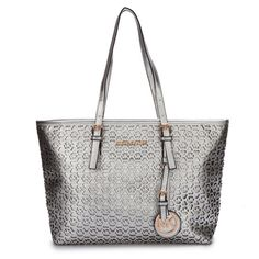 I Love it! Michael Kors Jet Set Monogram Travel Large Silver Totes. Click on the image to see more! #MKTimeless #NYFW