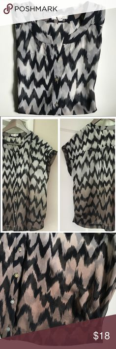 """Sheer, Printed Blouse From Nordstrom Rack. Short/Cap sleeves. Loose fitting. Sheer, will need a cami underneath. About 23"""" long from top of shoulder to middle of hem. When laying flat, measures about 22"""" from underarm to underarm. Six buttons down the middle. 100% polyester. Pleat detail at hem on each side. There is a slight run in the fabric at the top left shoulder (when wearing) - see last photo; it's hard to see in the pattern. Pleione Tops Blouses"""