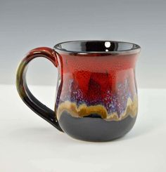 "These Large mugs are 4"" high by 3.5"" wide and hold between 12 and 14 ozs, Desert Red glaze - black, reds, sandy gold, with a touch of blue."