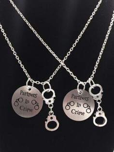 "Who is your Partner In Crime? Great set for best friends, sisters, or couples! The circle is a stainless steel charm. Silver tone and approx 22mm. The chain is silver plated link chain and is 18"" long. Has lobster clasp closure on the chain. Includes silver tone handcuff charm. Listing includes 2 necklaces. Keep one and give the other to someone special!! Gorgeous!!!"