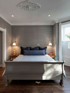 pale grey grass cloth for master bedroom- navy accents