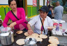 Street vendor selling freshly grilled arepas in #Colombia