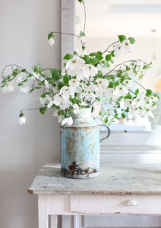 old jar with white flowers