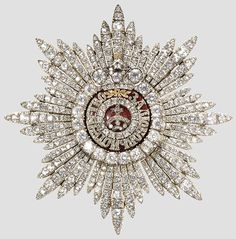 Star of The Order of St. Catherine : Empress Alexandra and all four of the Grand Duchesses took their sashes with the badges and stars with them into exile in Siberia. They were recovered in 1933. The Empress is the Grand Mistress for life. Therefore, the Dowager Empress Marie who escaped the Revolution with her life was the Grand Mistress.