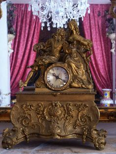 Gold Antique clock of Victorian couple
