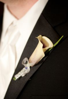 My groom's boutonniere. Picasso calla lilly with lilly grass. (Photos by Foto Bella Photography 2012)