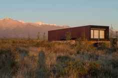 a4estudio elevates copper-toned home to frame the andes mountains