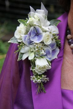 Purple and lavender Corsage for Mom  I like this too for mom only on wrist and much smaller but white and maybe a few blue orchids?