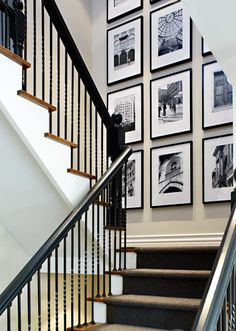 photo wall on stair landing...I love the organized look of same size frames and hung in rows...no weird layouts with mismatched frames for me.