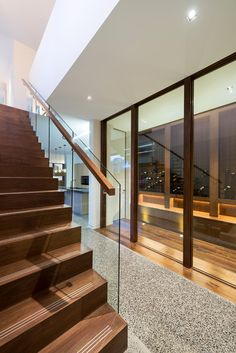 """Contemporary Hall by Dig Design  houzz """"The transition zone is a dynamic space flanked on one side by a wine cellar and by floating stairs on the other."""""""