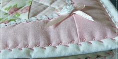 Three Excellent Tutorials for Using Decorative Machine Stitches to Secure Bindings! The beautiful machine embroidery stitch used to secure the binding of a lovely quilt got us to thinking about bindings. The standard approach is to stitch them down by hand or machine, making the stitching as invisible as possible. Some quilters will stitch down …