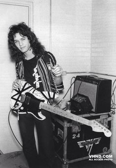 Eddie Van Halen ready to rock a sold out crowd in Japan in 1978. He's proudly wearing the original Van Halen logo tee from the band's club days. To this day, that very shirt that he wore during the band's first world tour hangs on display at 5150 Studios. Via VHND
