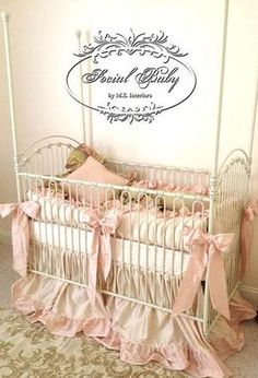 bratt decor's venetian crib is decked out in this wonderful pink & beige bedding set by M.S. Interiors