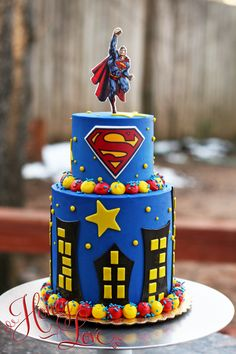 Superman birthday cake. Follow HoneyLove Cakery on FB, Twitter, and Instagram.