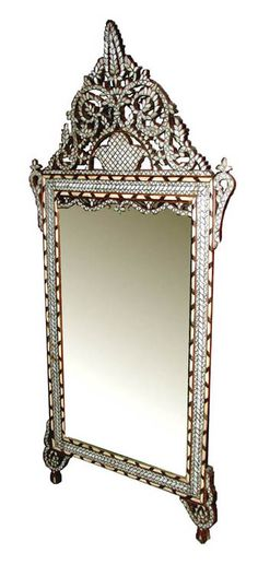 Middle Eastern :: Fabulous  reproduction of an antique from Damascus. Mirror frame is solid walnut and is completely covered with small mother of pearl shapes carefully hand fitted into silver wire and edged in a bone/walnut border.